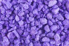淡紫色背景石头 库存照片