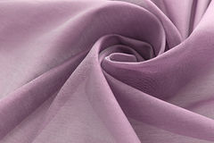 淡紫色背景豪华布料或难看的东西丝绸纹理缎天鹅绒波浪折叠  图库摄影