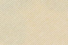 淡黄色被编织的织品纹理或背景 免版税库存照片