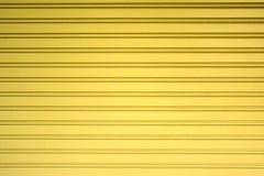 淡黄色金属板幻灯片门纹理背景 图库摄影