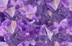 淡紫色紫色的宝石宏观无缝的背景 库存图片