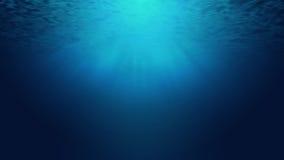 深深光束和海或海洋水下作为背景 库存照片