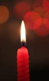 深红背景的蜡烛 库存图片