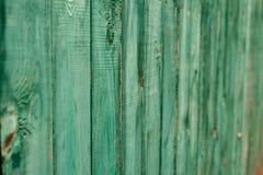 深绿老木板 背景和被绘的纹理篱芭 正面图 吸引美好的葡萄酒背景 库存图片