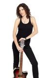 深色的卷曲吉他 免版税库存照片