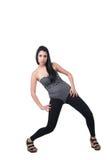 深色的夫人穿戴黑色绑腿、紧身连衣裤和楔子凉鞋 库存照片
