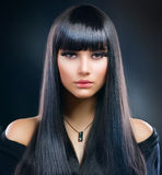 深色的女孩头发健康长 库存照片