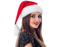 深色的女孩画象圣诞老人帽子的 库存照片
