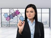 深色的女实业家画在玻璃屏幕上的一个七巧板 库存图片