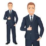 深蓝套装的商人微笑并且显示赞许 典雅,英俊的人全长画象在丝毫隔绝的衣服的 免版税库存图片