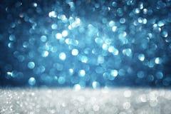 深蓝抽象背景,蓝色bokeh摘要点燃 库存照片