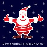 深蓝背景的五颜六色的圣诞老人 图库摄影