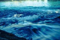 深蓝色河 库存图片