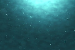 深蓝色海浪优质完全无缝的圈从水下的背景的与微微粒流动 免版税库存照片