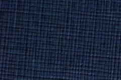 深蓝被检查的纸纹理背景,宏观射击 免版税图库摄影