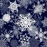 深蓝雪花无缝的样式 库存图片