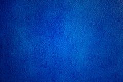 深蓝绘画粗砺的墙壁 免版税库存图片