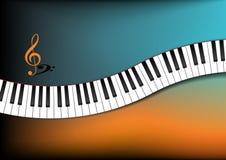 深青色和橙色背景弯曲的琴键 免版税库存照片