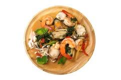 混乱油煎了辣海鲜用混杂的草本,泰国食物 免版税图库摄影