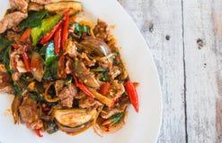 混乱油煎了野公猪用红色咖喱,泰国食物概念, 图库摄影