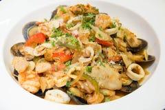 混乱油煎的混杂的菜用海鲜 库存图片
