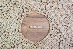 混乱,混乱的,在信件的词德国文本在立方体在桌上切成小方块 库存图片