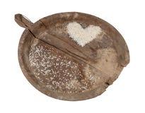 混乱黏米饭的古老木盘子  免版税库存照片