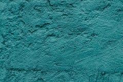 混凝土墙绘了装饰设计的绿松石 抽象概略的纹理背景 蓝色难看的东西构造了墙壁背景 免版税库存图片