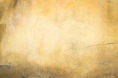 混凝土墙绘了桔黄色水泥纹理作为backgroun 库存照片