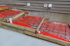 混凝土的室外在建筑物内装设的取暖用电热器 免版税库存照片