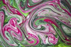 混杂的墨水夏天明亮的抽象背景是桃红色和绿色的 免版税库存照片