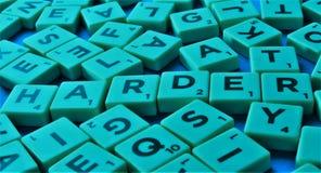 混杂的拼字游戏瓦片尝试 免版税库存照片