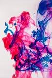 混杂的油漆在水中 免版税图库摄影