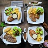 混杂的牛排(;大鲭鱼牛排,鲑鱼排,丁骨牛排,r 免版税库存图片