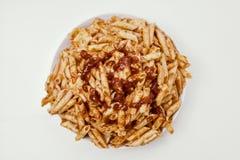 混杂的面团用西红柿酱 免版税库存图片