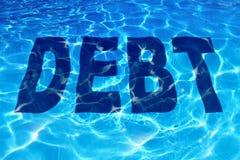 淹没在债务 免版税库存图片