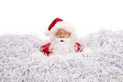 淹没在切细的纸的圣诞老人 免版税库存照片