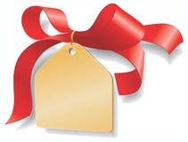 添加金黄这里镀您红色丝带的文本 免版税库存照片