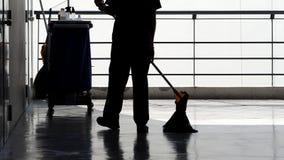清洁服务人详尽的地板剪影  免版税库存照片