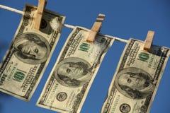 清洗货币 免版税库存图片
