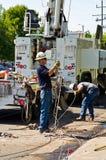 清洗路技术人员  库存图片