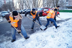 清洗雪工作者 免版税库存照片