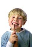 清洗他的ii牙的男孩新 免版税图库摄影