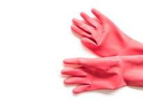 清洗的特写镜头红色橡胶手套在白色背景,工作 库存图片