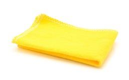 清洗的黄色布料在白色 免版税图库摄影