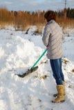 清洗雪妇女 免版税库存图片