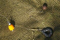 渔与渔主角的鲤鱼船具 库存照片