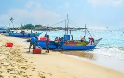 渔乘员组工作  库存图片