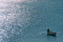 渔夫划船 库存图片