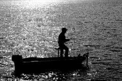 渔夫剪影 免版税库存照片